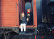 little boy and the little girl in the retro train