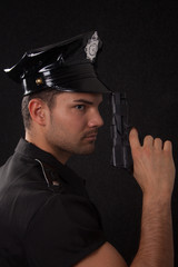 Young policeman with gun