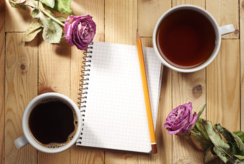 Cup of tea, coffee and notebook