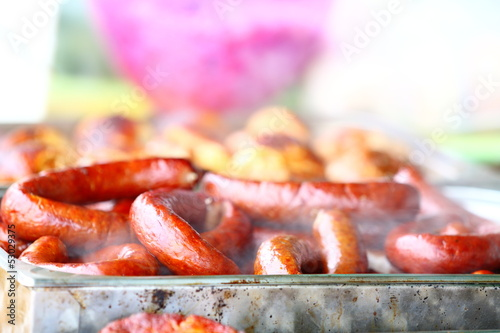 sausage and other meat on BBQ