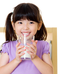 Asian girl drinking milk