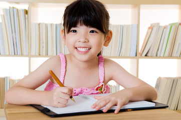 Asian girl writing