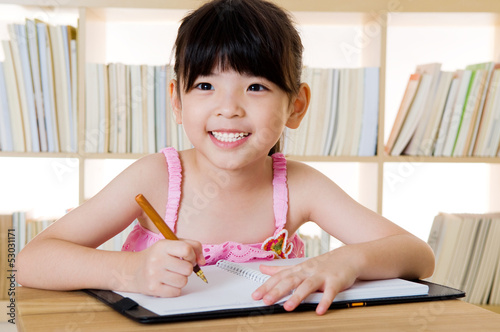 Asian girl writing
