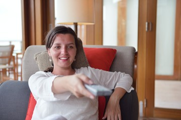 happy young woman relax at home on sofa