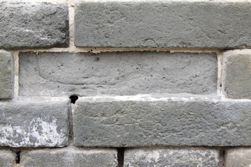 Broken gray brick wall in rural
