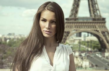 Sepia photo of fashion woman in romantic city