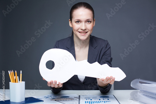 Businesswoman with key