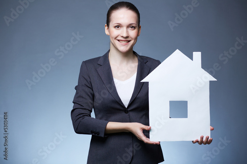 Woman with paper house