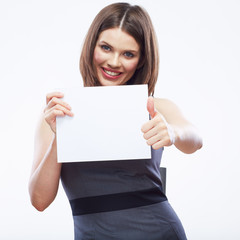Business woman hold white blank paper. Young smiling girl show