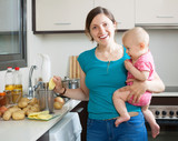 Happy woman with child  cooking mashed potatoes