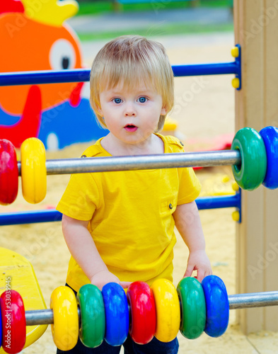 Baby boy with colorful wooden counting frame