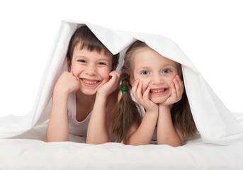 children hiding under the blanket