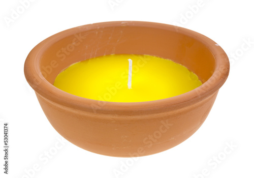 Large citronella candle in clay bowl