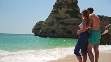 Couple in love standing on beautiful exotic beach