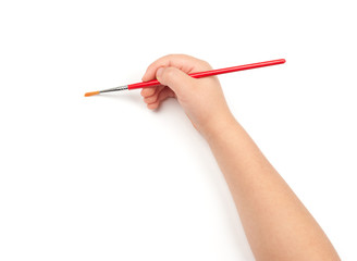 paintbrush in child hand