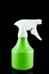 Green plastic sprayer isolated on black background