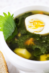 Nettle soup with egg and bread