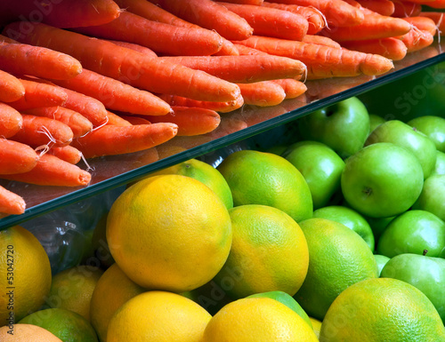 Vegetables and fruit on the counter in the store.