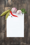 Spices and garlic on wooden background with paper for notes