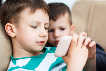 Little boys playing on smartphone