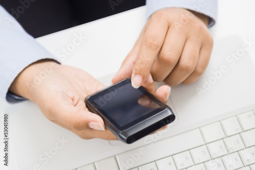 Business woman hands with smart phone at office