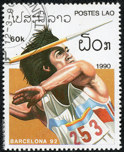 stamp printed by Laos, shows athlete throwing javelin