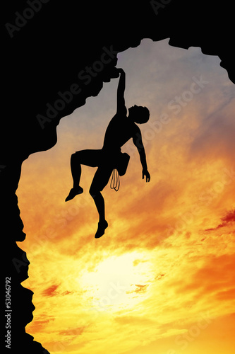 free climber at sunset