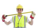 Apprentice holding builders tape measure