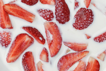 slices of strawberry in milk