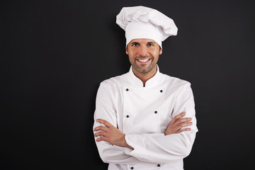 Portrait of smiling chef in uniform.