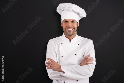 Portrait of smiling chef in uniform. - 53049956