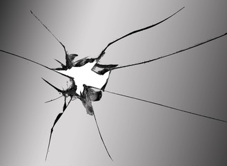 broken glass, macro photo of the cracked hole