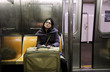 Woman with Suitcase in New-York Subway