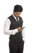 Indian young businessman with mobile phone