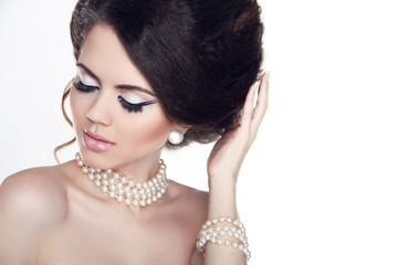 Jewelry and Makeup. Fashion portrait of beautiful woman with pea
