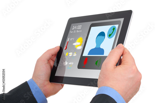 Businessman using tablet to video-conference.