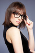 sensual young woman wearing glasses