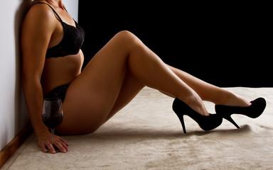 Woman in black underwear sit