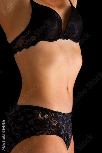 Woman in black underwear stand