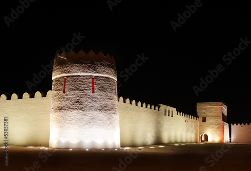 Beautiful illuminated eastern tower and walls of Riffa fort