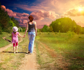 Mother with daughter on the green field