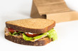 Turkey tomato and lettuce sandwich brown bag lunch - 53058163