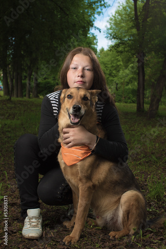 Portrait of the girl with a dog