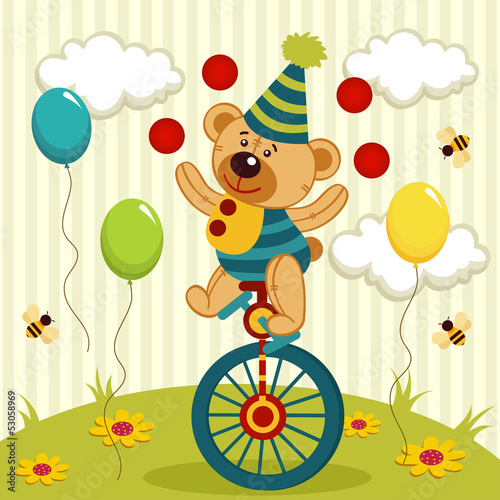 bear clown juggles and rides a unicycle