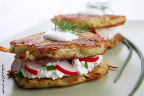 Potato pancakes with cream cheese