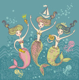Three little funny mermaids playing in the sea waves.