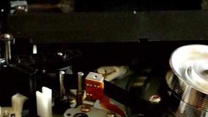 Cassette videotape recorder inside. Dolly shot