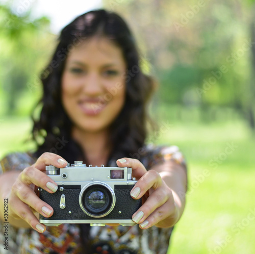 Portrait of woman holding vintage camera - Focus on camera (retr