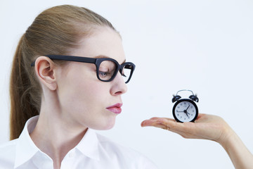 Woman with black clock. Time management concept.
