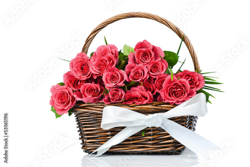 Fresh roses in the wicker on white background
